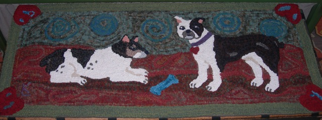 This is Thumper [l.] and Beans [r.].  This is a topper for an antique trunk at the foot of our bed.  It provides a launching pad for the doggies to get onto the bed.