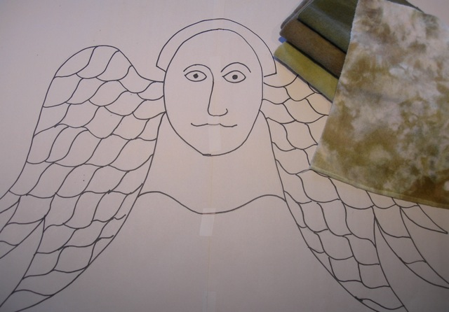 My angel design with the dyed wool for the face and some for the wings.