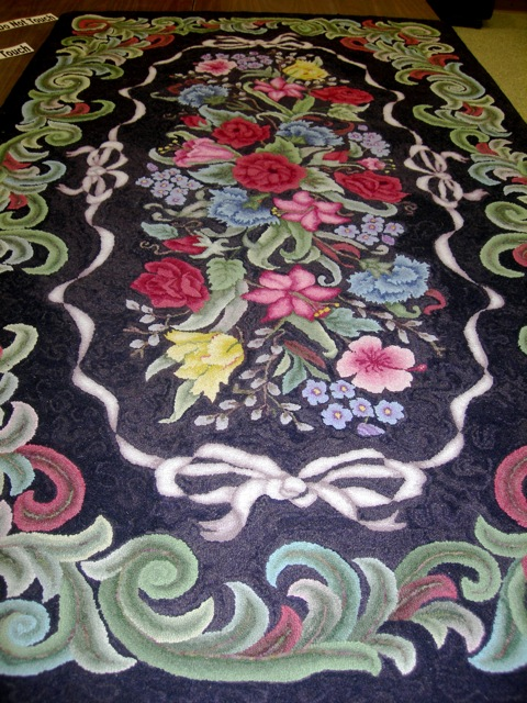 This beautiful LARGE rug designed by Pearl McGown and hooked by Helen B. Lynch.