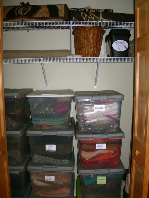 There are three closets in the room.  This one holds my wool stash, linen, and rolled up finished rugs.