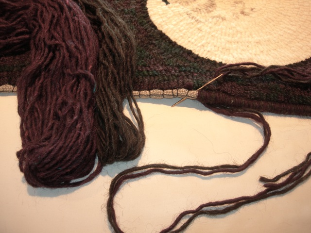 I whipped the edge with two strands of wool, one charcoal grey and one burgundy.
