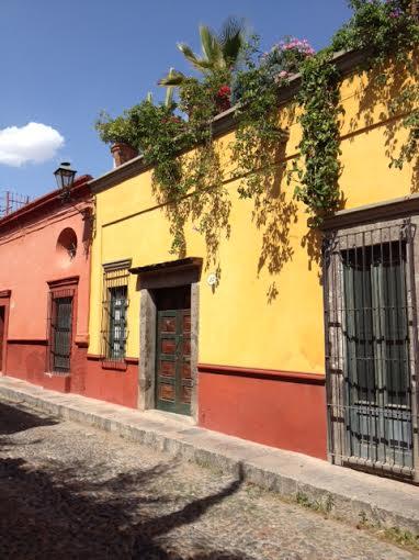 Climb steep cobblestone streets