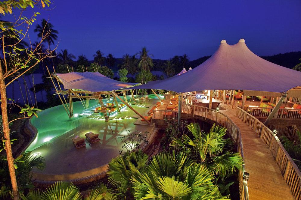 021-SK-Soneva_Kiri_Resort_Thailand_-_Main_Pool_Night_by_Jerome_Kelakopian (1).jpg