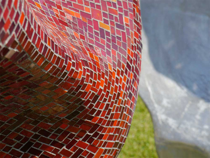 The skill of great mosaic work: transforming hundreds of tiny pieces of sharp cut glass into a sensuous smooth curve.