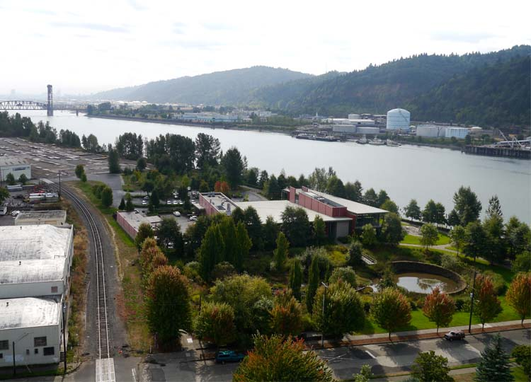 The Water Pollution Control Laboratory is the red building in the centre of this image, surrounded by extensive gardens. Downtown Portland is on the opposite riverbank in the distance.