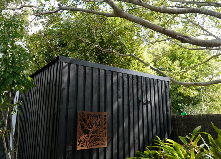 Chunky, dark stained timber wraps the pavilion. Translucent panels open to allow additional light and ventilation.