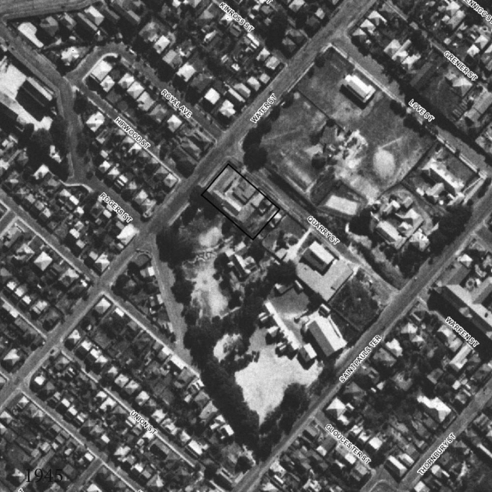 1946 An aerial photograph from Brisbane City Council shows the rock cutting at the back of the site.