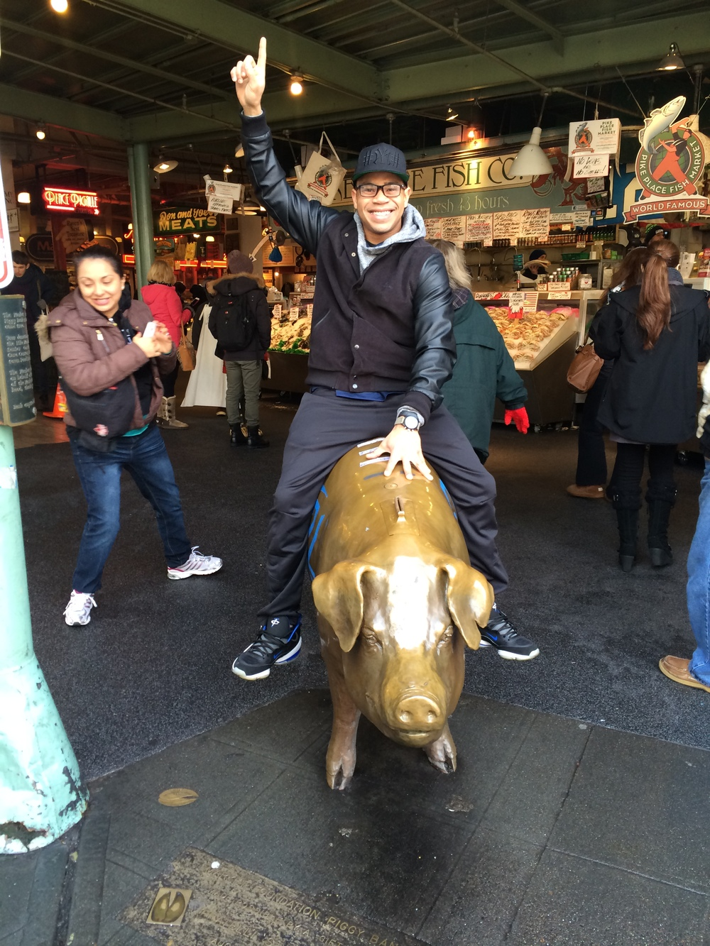 A Ride on the 12th Man pig inside the world famous Pike Place Fish Market
