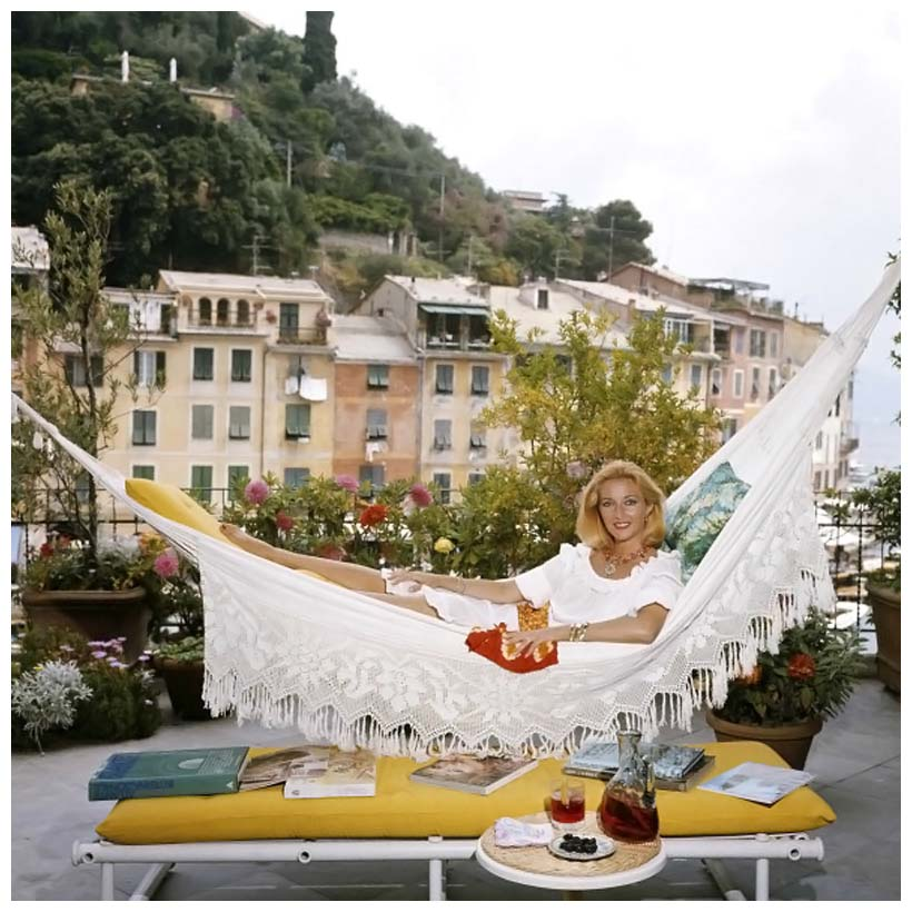 daniela-bianchi-poses-in-a-hammock-on-the-terrace-of-her-apartment-in-portofino-italy-in-august-1977-photo-by-slim-aarons.jpg