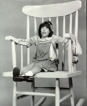Lily Tomlin as Edith Ann in rocking chair