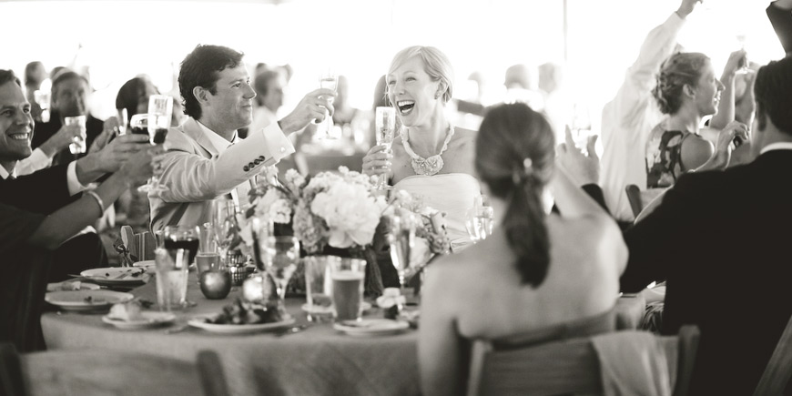 tented wedding reception toast