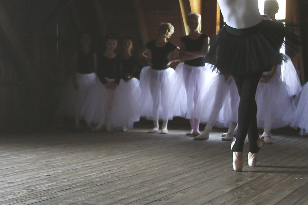 Stella's ballet recital. Classical music, little girls dancing in a beautifully lit space.
