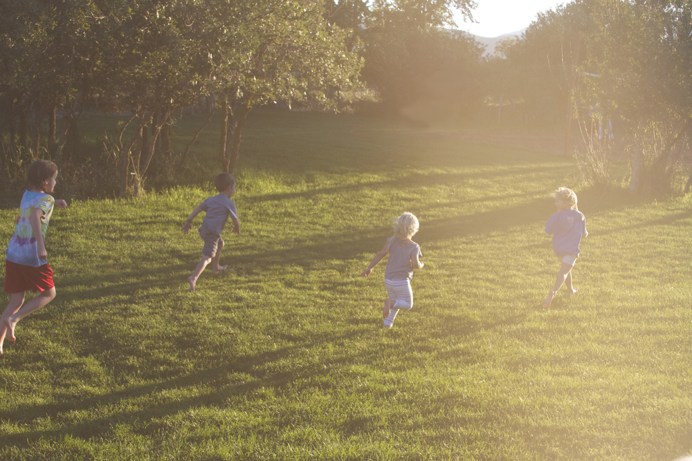 At a cabin tucked away in the mountains, playing tag with cousins at twilight, barefoot, on grass that feels like carpet.