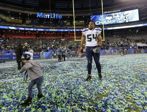 Linebacker Bobby Wagner celebrates with his daughter after winning Super Bowl XLVIII.  (AP Photo/Ted S. Warren)