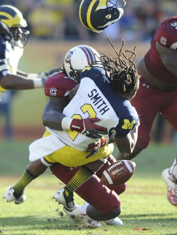 Jadeveon Clowney set the world on fire when he blew up Michigan running back Vincent Smith in the 2013 Gator Bowl.  (AP PHOTO)