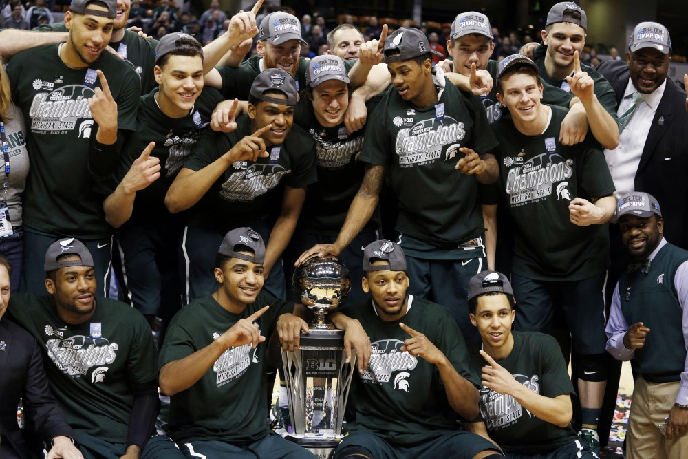 Michigan State won their 4th Big 10 title, tying Ohio State for most in Conference history, after they defeated rival Michigan 69-55. (AP Photo)