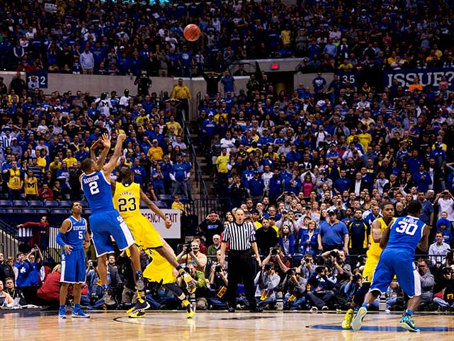Aaron Harrison went 0-4 in the first 32 minutes of the game. For the Final 8 minutes he scored 12 points, going 4-4 from behind the 3-point line, also knocking down the game winning shot with 2.7 seconds left on the clock. (David E. Klutho/SI)