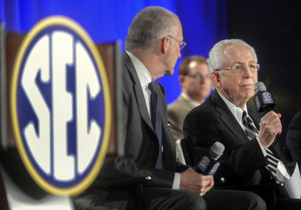 SEC commissioner Mike Slive  will receive $1.2 million as his base pay, up from the previous $230,000 he received in 2010-2011. (AP Photo/John Amis)