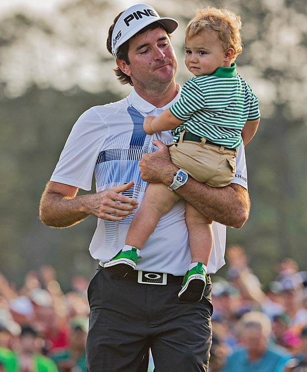 Bubba Watson with his 2 year old son, Caleb, after winning the 2014 Masters. (Simon Bruty/SI)
