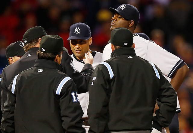 Umpires check Pineda neck for pine tar right before he was ejected from the game.