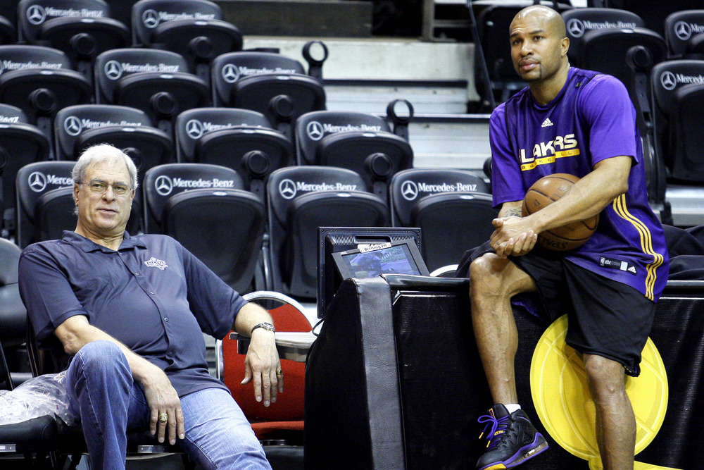 Phil Jackson coached Derek Fisher for 9 seasons in LA, winning 5 championships together. (AP Photo)