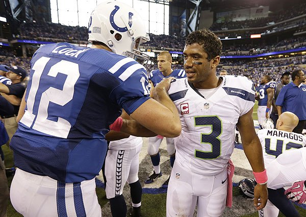 Andrew Luck and Russell Wilson could become the new Flacco-Ryan rivalry. One put up numbers the other wins games. Both have big pay days in their future. (AP Photo)