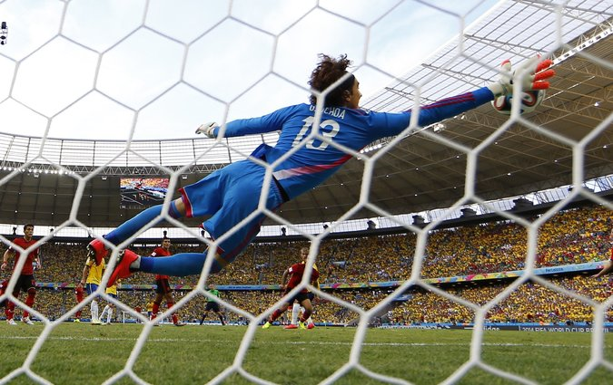 Ochoa beautiful save in the first half, stopping Neymar's header. (Kai Pfaffenbach/Reuters)