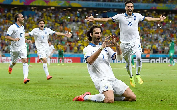 Georgios Samaras celebrates after scoring the game winner to send Greece into the knockout round. (Getty Images)