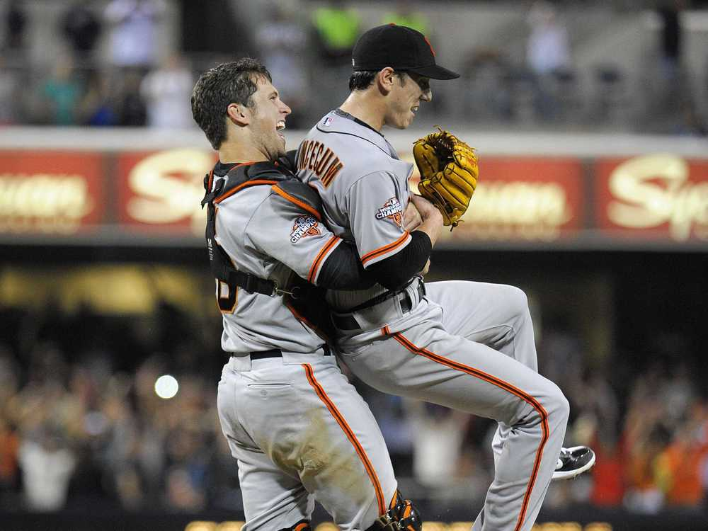 Buster Posey picks up Tim Lincecum after completing his first career no-hitter against the Padres. (AP Photo)