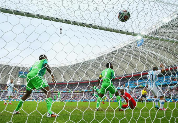 A behind the goal shot of Lionel Messi's first goal, only 3 minutes into the game.  (Ian Walton/Getty Images)