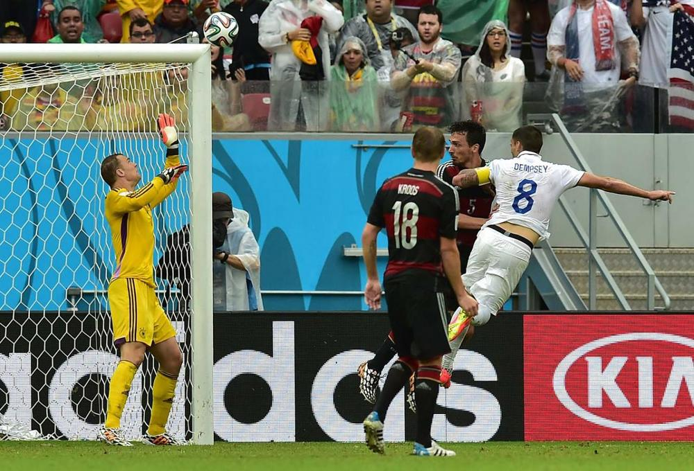 Clint Dempsey attempts a header but it sailed over the goal. That was the closet the U.S came to scoring against the Germans in their 1-0 loss. (Getty Images)