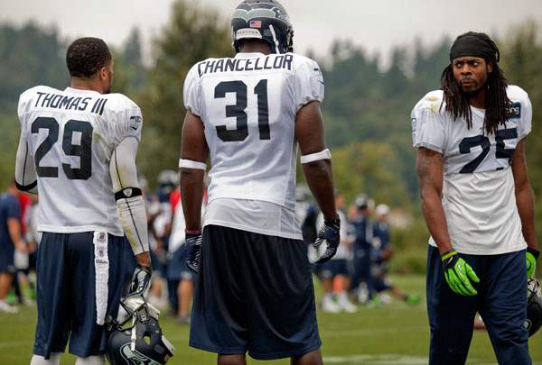 Sherman is able to do what he do because he has these two behind him. And they are able to play closer to the line of scrimmage because they play with corners like Sherman that don't need much help. Ultimately, they are the most cohesive unit in the NFL. (AP Photo)