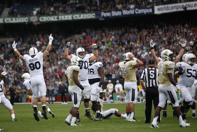 Penn State players celebrate after kicker Sam Ficken hit a 36 yard game winning field goal as time expired, 26-24 final score.