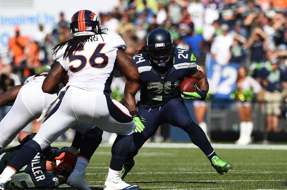 Beastmode has been balling out in the first three games, averaging 4.5 yards a carry and 3 TDs. Last Sunday he won the game with a 6 yard run up the middle. On the final drive to keep Peyton Manning on the sideline, Marshawn rushed for 18 yards on 3 carries. (John McDonough/SI)