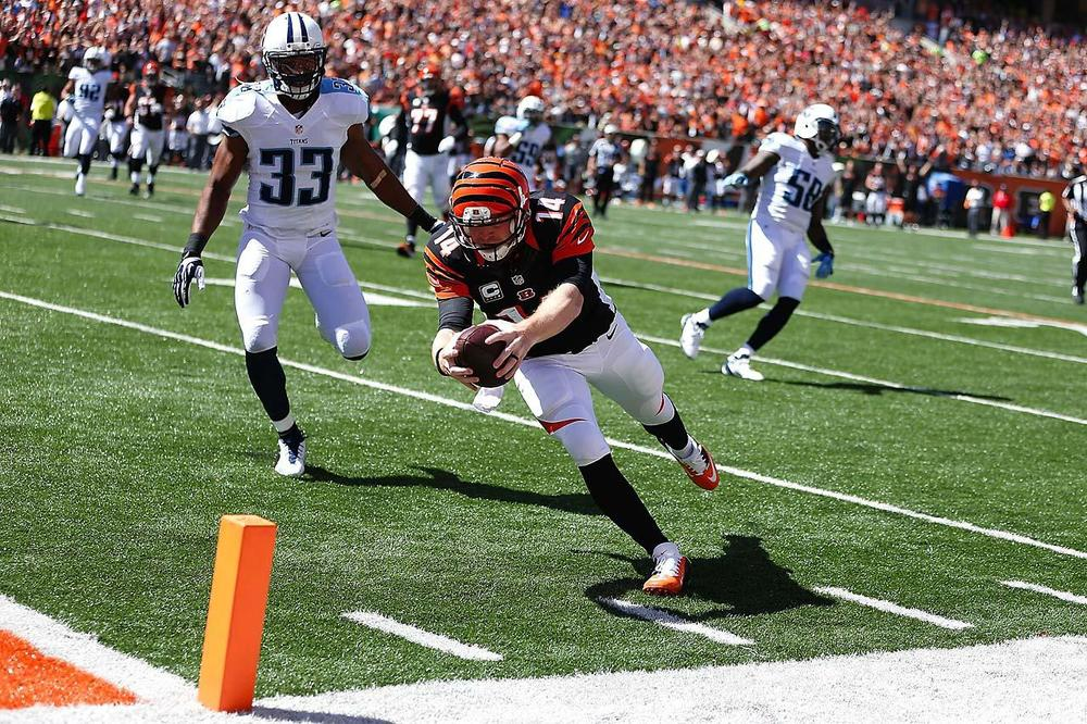 Andy Dalton has high expectations this season. Red Bomber has put the Bengals in the post season the last 3 years, but all have resulted in 1st round exits.In the off-season, Dalton signed a new contract worth more than $100 million and I'm sure 1st round exits aren't apart of the deal. (Bruce Yeung/SI)
