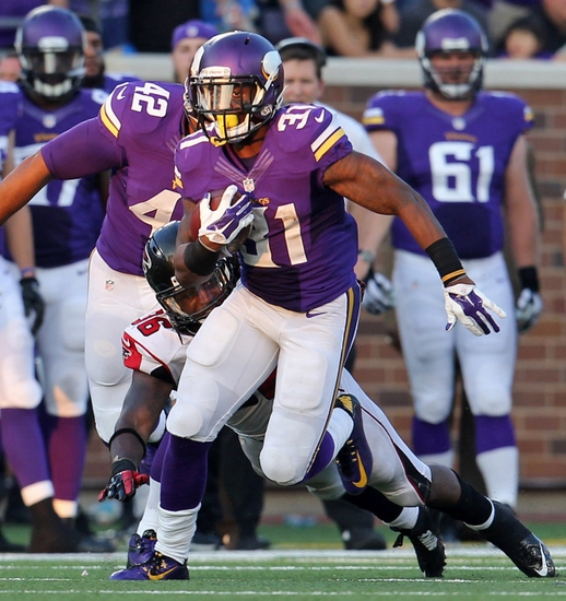 Vikings played physical Sunday. 241 rushing yards and 4 TDs as a team on the Falcons proving that running the ball ain't dead, coaches just scared. (Ann Heisenfelt/AP)