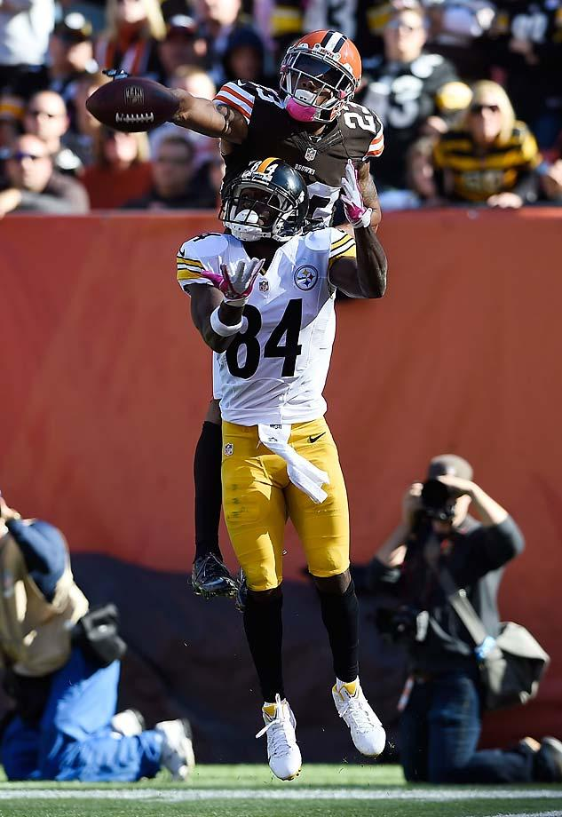 A cool shot of Joe Haden breaking up a pass intended for Antonio Brown. (Jason Miller/Getty Images)