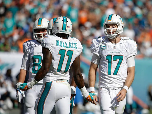 Ryan Tannehill (17) led the Dolphins to a 37-0 victory with his great performance, throwing for 3 TDs and 288 yards. (AP Photo)