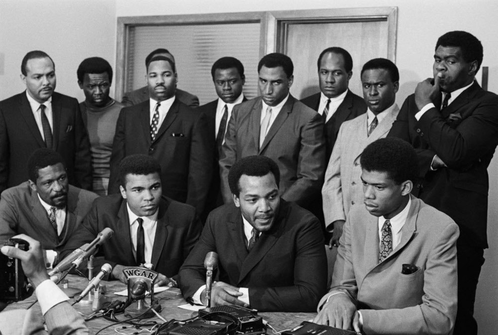 Left to right: Bill Russell, Muhammad Ali, Jim Brown, and Kareem Abdul Jabar. This was during a meeting in Cleveland where the other 3 black superstars came to support Ali, after he announced he would not go fight in the Vietnam War.