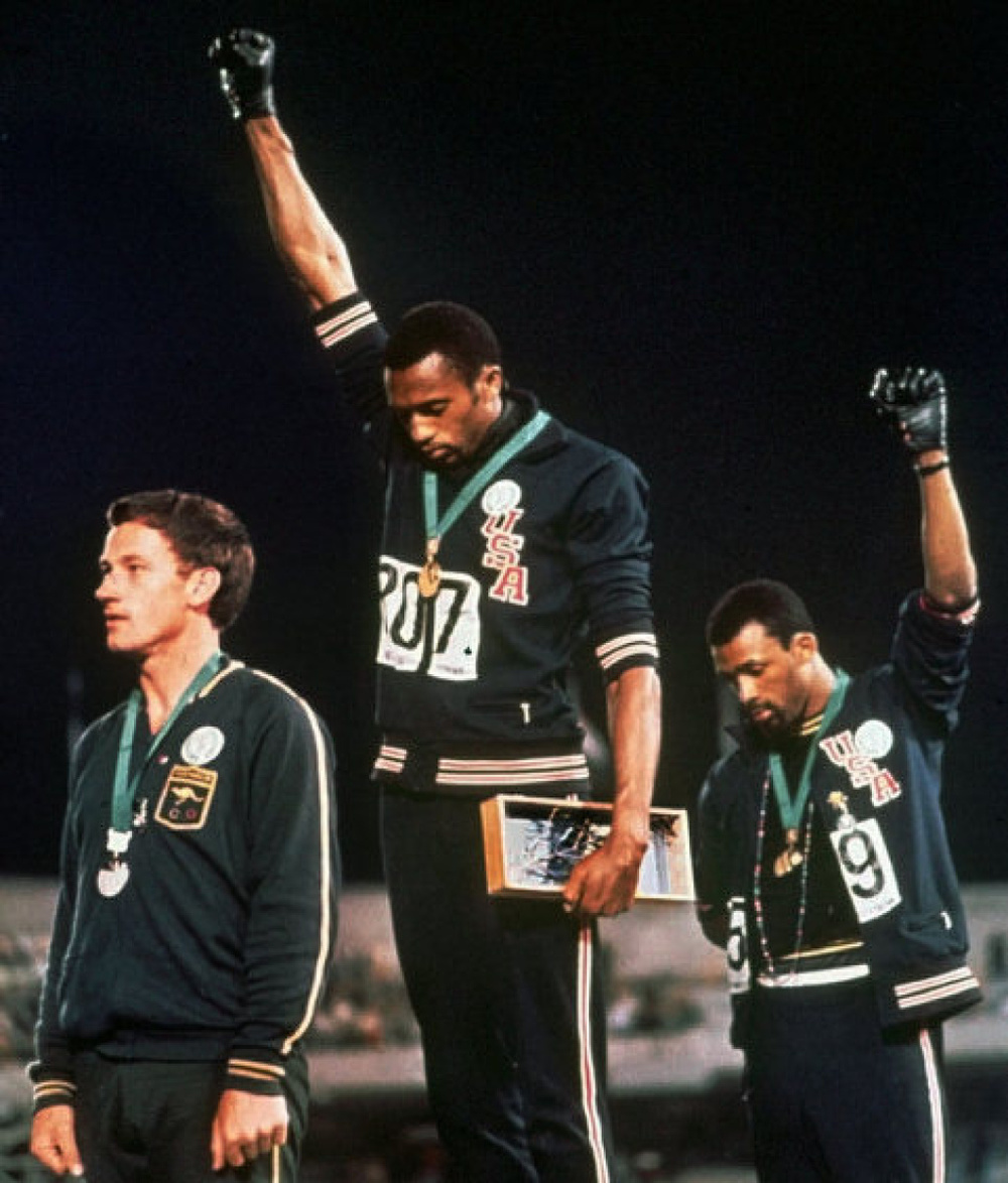 Tommie Smith (center) and John Carlos (right) did this powerful gesture in 1968 Olympics during the National Anthem. What look so simple, in fact turned out to be one of the most powerful gestures in sports history. Of course, they were shunned andchastise by the same country they represented and won medals for, but I'm sure they was prepared for that when they made powerful gesture.