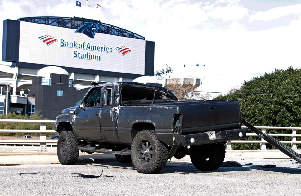 Cam Newton's truck after it flipped a few times sitting in front of Bank America Stadium. Luckily Cam Newton will live from this accident. (AP/Skip Foreman)
