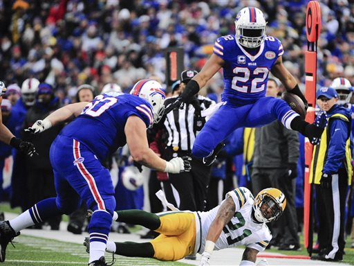 Fred Jackson leaping over a Packers defender during the Bills 21-13 victory. (AP Photo)