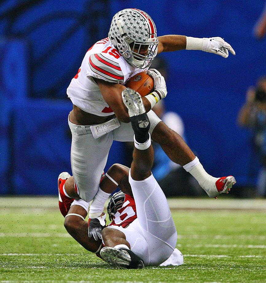 With 3:24 remaining on the clock, Elliot bust it for 85 yards that pretty much sealed the game for the Buckeyes. In his last 4 games, Elliot has rushed for 678 yards and 7 TDs. Someone is in the zone. (Al Tielemans/SI)