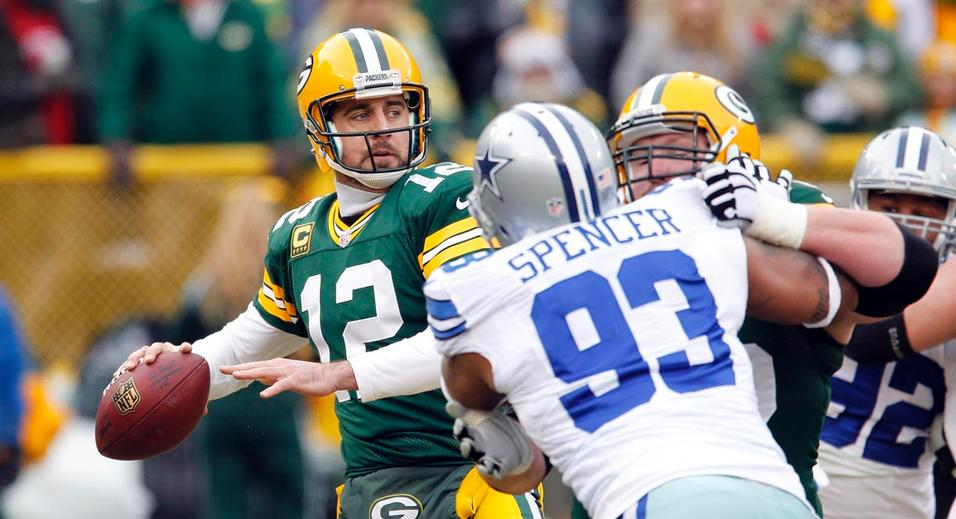Rodgers injury didn't handicap him to the point that he could not be productive. Cowboys struggled to make him scramble allowing him to pick them apart. (AP Photo)