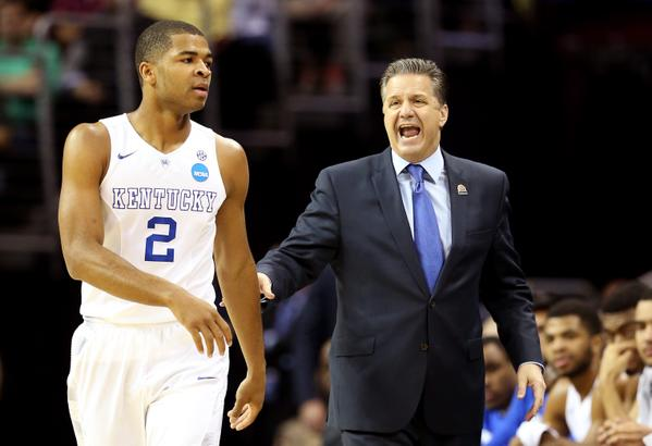 John Calipari told his team to be the aggressors in order to beat the press and that's what they did. In the first half. the Harrison Twins combined for 20 points in the first half, 2 more points than the entire West Virginia team. (AP Photo)