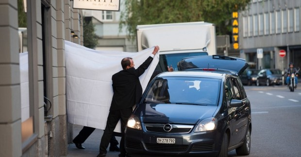 Top FIFA officials being covered by white sheets after being taking into custody by the Swiss Police. (dailymail.co.uk)