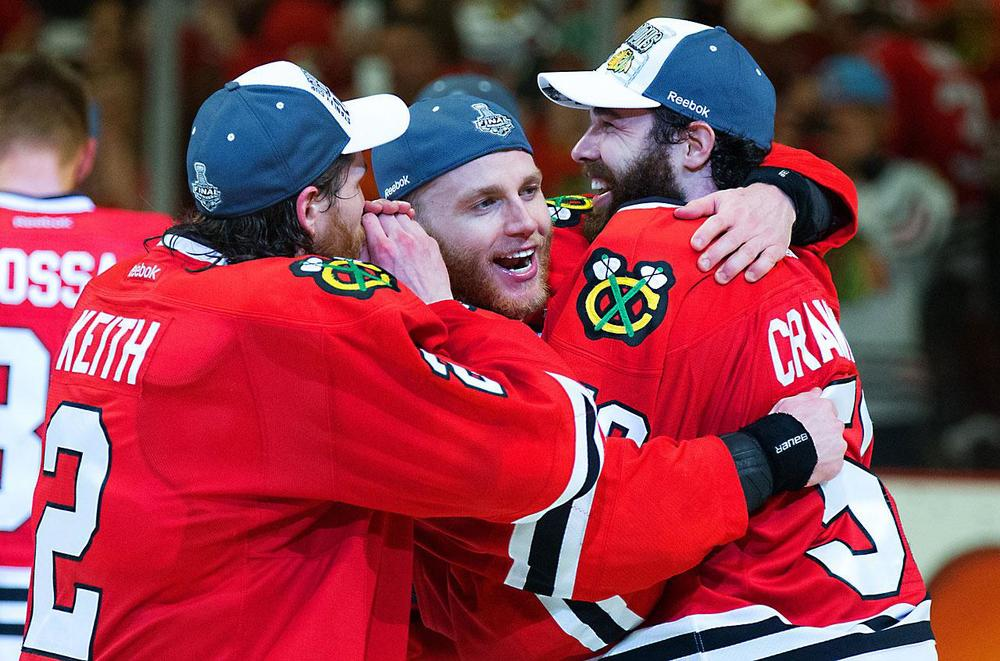(left to right) Duncan Keith, Patrick Kane, and Corey Crawford all celebrate after winning game 6. Keith and Kane combined for 6 points during the Cup Finals, while Crawford posted his 5th shutout of the postseason. (David E. Klutho/Sports Illustrated)