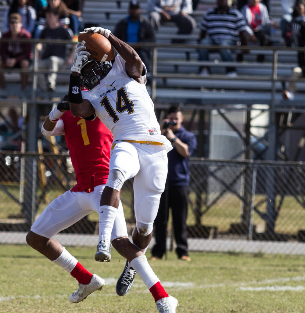 Tajh Capehart goes up for a catch against a Bayside High defender in 2015. Capehart along with a few other Ocean Lakes players, transferred to Bishop Sullivan in the 2016 season. (James Sneed/Fan-I Sports)