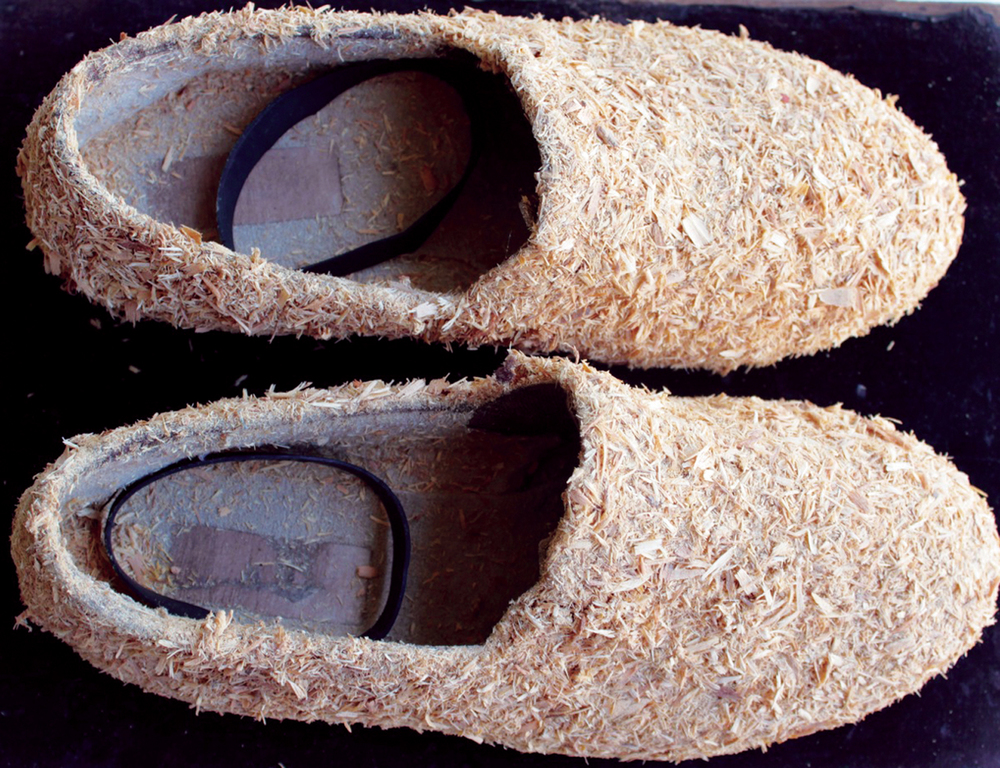 7. Nalda Searles,  The Shape Changers Slippers , mans slippers c.1997, sandalwood shavings from lathe work c.1993, rubber bowyangs, set with  Return  $2,900