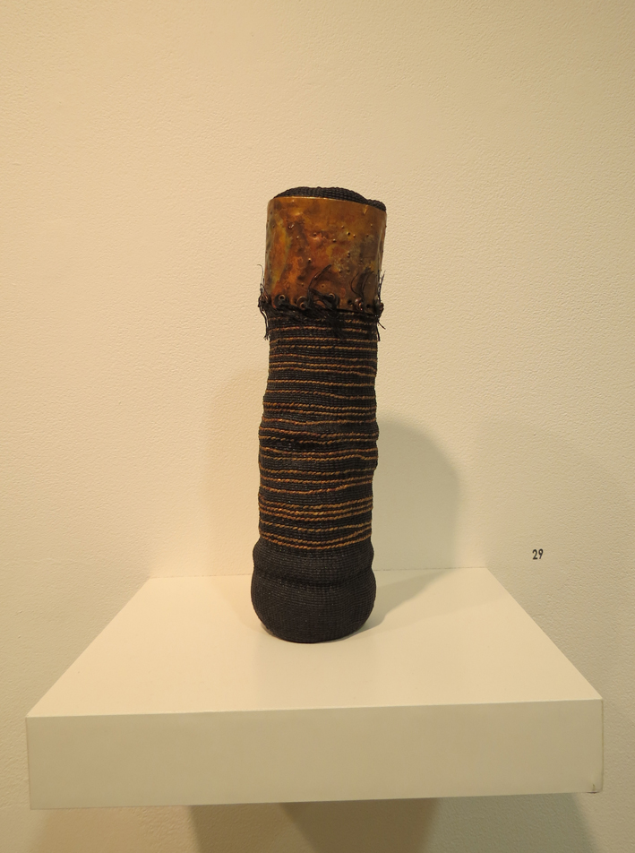 29. Mary Hettmansperger,  Endless , black twined waxed linen vessel with copper, copper metalic linen, $650